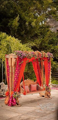 This decorated swing is perfect for an outdoor indian wedding event; Get some indian wedding color ideas too! #IndianWeddingIdeas