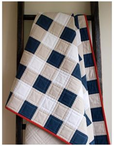 "Navy Buffalo Check, Plaid Organic Cotton Throw Quilt; Handmade Navy, Beige, White Patchwork Quilt with Red Trim; Modern Rustic Quilt #red #patchwork #quilt #redpatchworkquilt This stunning organic cotton patchwork quilt is set in an iconic buffalo plaid pattern. Featuring 3"" squares of navy blue, white, and 'Ash' (a pale grey-beige), this rustically modern quilt is intricately pieced, heavily machine-quilted, and is hand-bound with a striking red edge. It is layered with organic cotton… Quilting Projects, Quilting Designs, Gingham Quilt, Navy Quilt, Rustic Quilts, Boy Quilts, Denim Quilts, Quilt Modernen, Patchwork Quilting"