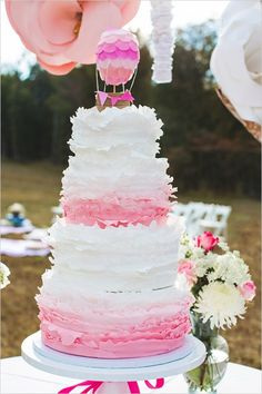 pink ruffle wedding cake with hot air balloon topper