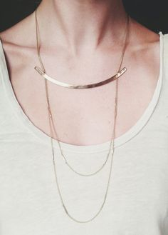 "Hammered solid brass arc flanked by hand-stamped arrows. Two tiers of vintage segmented brass chain are suspended underneath.  Wear the chains over or under shirt.Necklace chain is adjustable by 1.5"" Available with bronze arc as well."