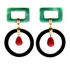 These vintage Chanel earrings from the 1960s (via 1stDibs) just stopped me in my Internet-surfing tracks. The nod to art deco and the simplicity of design combined with the edited yet striking colo...