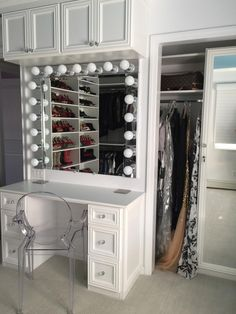 Designer Courtney Blaymore closely followed her client's wishes by installing a make-up vanity inside this walk-in closet and dressing area. Especially fetching is the lighting around the vanity mirror, which gives an impression of old Hollywood. A ghost vanity chair completes this fabulous look.
