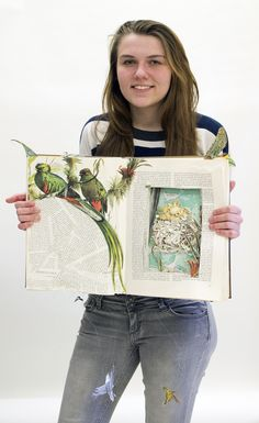 Photo of Abigail Van Camp with award-winning artwork
