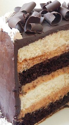 Heaven and Hell Cake (Devil's Food cake Angel Cake Peanut Butter Filling all topped with Chocolate Ganache)