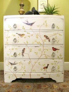 Check out this dresser re-do with Mod Podge and bird graphics