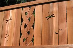 Dragonfly cedar art fence. Not just an ordinary fence. I love the extra effort to make it pretty.