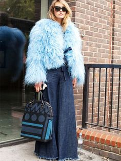 Tess Yopp wearing a Marques'Almeida faux fur blue jacket and wide-leg jeans.