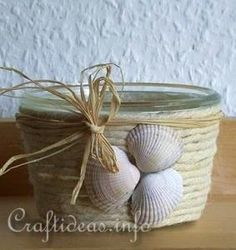 This site has a ton of sea shell crafts, most of which seem pretty easy.