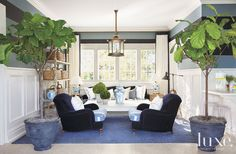The blue theme carries into the pool house, where Long put a coastal spin on the regal color with a ragged- stripe floorcovering by Patterso...