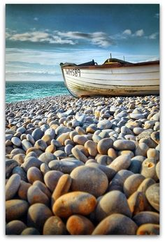 Boat on rocky beach