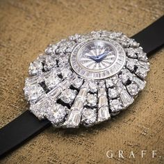 Graff Diamonds - Framing the ex-centred dial of the Peacock watch is a burst of…