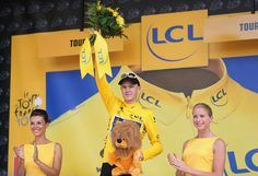 TOURS, FRANCE - JULY 11: Chris Froome of SKY Procycling celebrates on the podium after retaining the general classification lead and Maillot Jaune after stage twelve of the 2013 Tour de France, a 218KM road stage from Fougeres to Tours, on July 11, 2013 in Tours, France. (Photo by Bryn Lennon/Getty Images)