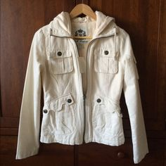 """BB Dakota cargo utility jacket (Bella in Twilight) This ivory jacket is similar to the Bella one worn by Kristen Stewart in the Twilight movie except that it doesn't have zippers above the front pockets. Juniors small. Tried on M but didn't like. Typically wear S in BB Dakota   22"""" long back of neck to bottom Distressed edges on bottom and end of sleeves 4 functional pockets in front Matching pocket on arm  Drawstring collar  Attached hood made of cotton sweatshirt material 100% cotton body…"""