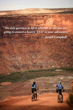 A couple enjoys riding the White Rim Trail in Canyonlands National Park