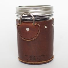 These mason jar holders are such an amazing concept and so well made that we think everyone should have one. Reclaimed leather is hand-stitched around a mason jar, creating a removable jar cozy, complete with a bottom and a d-ring so that you can attach it to your bag, or your bike, or whatever you want. The list of uses includes, but is not limited to: hot or iced coffee, hot or iced tea, beer, soup, hot cocoa, water and more. Seriously. Talk about functional and easy on the eyes....