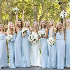 All the ladies lined up in Show Me Your Mumu Steel Blue Bridesmaid Dresses