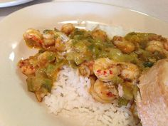 Crawfish Etoufee: a bed of rice smothered in a home-cooking mixture of Cajun trinity and crawfish tails
