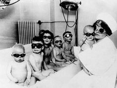 1920's,children and babies w/ nurse  in hospital for sunlamp therapy