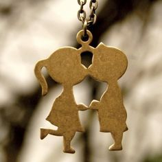 Boy and Girl Kissing 1960s Necklace by ragtrader on Etsy, $17.00 i used to have one like this when i was young
