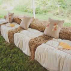 rustic wedding hay bale seating couch sheets pillows