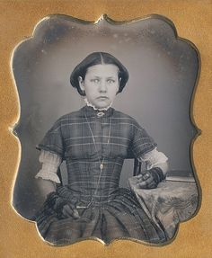 Teenager in fingerless lace gloves, that beautifully embroidered lace blouse underneath her plaid dress and lots of gold painted jewelry. Daguerreotype taken in the early 1850s. Via Dennis A. Waters Fine Daguerreotypes.