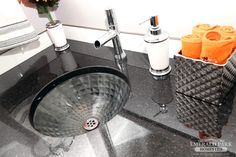 Black galaxy quartz counter tops with an under-mount sink and tube faucet