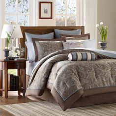 This 12-piece bedding set features a traditional jacquard print on its comforter. Paired with 200 thread count cotton sheets, the brown tone of this set features a blue accent and will easily pair with any decor.