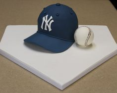 Another baseball hat cake.  This one is a birthday cake for a friend whos a Yankees fan.  Snickerdoodle cake with cinnamon buttercream, covered and decorated with fondant.   Hat brim is made from gumpaste. I made the baseball from white chocolate this time (its hollow), and the laces are painted on with red food coloring. For those wanting more info on how to make the hat brim, I found a great tutorial on it from the blog: Confections of a Cake Lover.