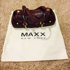 MAXX New York Burgundy Croc Bag Gorgeous, deep burgundy color. Comes with dust bag. Has only been used a handful of times, however note slight chip on gold hardware in photo 2. Interior is good, slight signs of use but sleek, clean bag overall. Gold hardware and magnetic closure. MAXX NEW YORK Bags Satchels