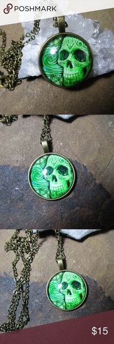 Green Celtic skull pendant necklace Green Celtic skull pendant necklace, bronze with a 20 inch chain. The skull is accented by Celtic knotwork designs. Accessories Jewelry