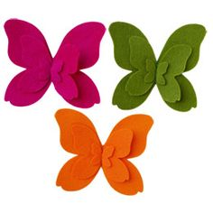 The Container Store > Felt Butterfly Tie-On. Might be tough as a felt barrette, since there are so many edges that could droop when unsupported. Maybe a modified design.