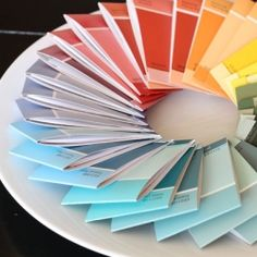 Use paint chips to make matchbook-style mini notebooks to carry around and give away.    So cute! Cheaper than moleskines, good use of scrap paper, and perfect size for stealthy muni-sketching.