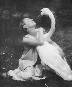 """Anna Pavlova (1881-1931): the most celebrated, internationally famous dancer of her time and interpreter of """"Swan Lake.""""  Born premature, she never became physically strong despite ballet practice, but her fragility and daintiness led her to develop rare qualities of expressiveness, delicacy, and fluidity of movement that enchanted audiences. Photo: with her pet swan Jack."""