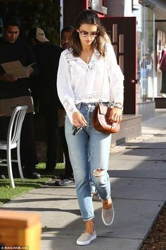 Alessandra Ambrosio wearing Linda Farrow 370 Sunglasses, Chloe Drew Small Crocodile-Embossed Shoulder Bag, Common Projects Smoke Slip-on Sneakers and Re/Done Jeans