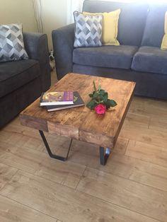 Solid wooden coffee table. Railway sleepers and steel legs.