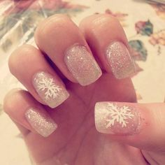 In time for Christmas! Silver glitter gel nails with snowflake design.