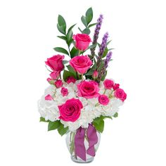 "A bright and bold combination of gorgeous hot pink roses and spray roses, white hydrangea, liatris and assorted foliage.  Designed in a clear glass vase and finished with a ribbon tie.  Remember your Mother's gentle love with the gift of this beautiful arrangement. Approximately 20""H  X 9""W"