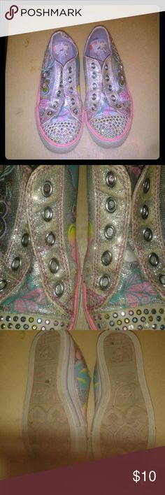Twinkle Toes girl skechers shoes Used  a couples of times, has slight peel off.but still in great condition.Has embellished stones.Marked size 2.5.Sparkle, shine and being, and best of all ,they light up! Skechers Other