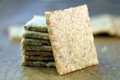 Easy egg-free paleo crackers recipe, made with almond flour, macadamia nuts, flax, and hemp. Grain-free, paleo, and perfect for those on a keto diet.