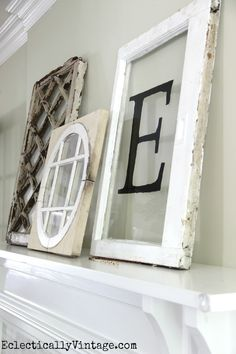 Antique window decor - perfect as a collection propped on a mantel eclecticallyvintage.com