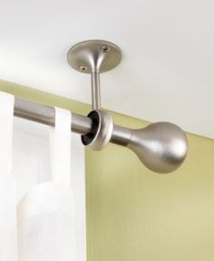 Hang curtains from ceiling mounted brackets. Avoid having to measure!