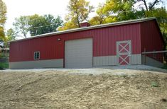 Visit the Lester Buildings Project Library for pole barn pictures, ideas, designs, floor plans and layouts. Pole Barn Garage, Sioux City, Building Systems, Horse Stables, Red Barns, Floor Plans, Construction, Flooring, Outdoor Decor