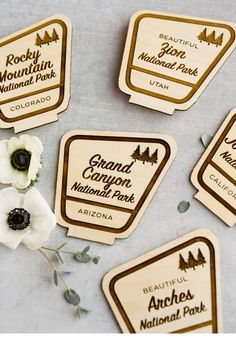 """From the editorial """"Every Adventure Seeking Couple Needs to See This Ranch Wedding With National Park Inspired Details."""" This couple has visited 25 US National Parks together and plans on visiting them all! The National Park table signs designed and produced by Sweet Zion Paperie were one of their favorite decor elements of their special day. More on SMP!  Photography: @tarabieleckiphotography  #weddingtable #weddingtablesigns #weddingdetails #weddingdecor #ranchwedding #rusticwedding"""