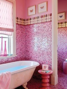 Pink, pink, pink, everywhere in this teen's bathroom. Bizazza iridescent glass mosaic tiles on the walls and floors layer of irridescent sparkle with the matte walls.  A white antique clawfoot tub adds the final feminine flourish.