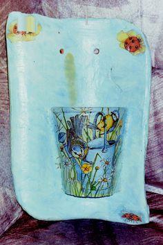 Dakpan met halve bloempot en servet uit 1995