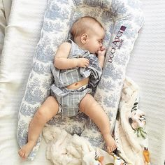 A dream in the DockATot Toile cover. Did you know all DockATot covers are still on sale for a limited time? Shop dockatot.com for this baby sleep essential. See what parents are raving about. Stylish baby gear with a purpose!