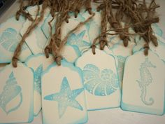 LOVE THESE SYMBOLS. Can be designed on anything.   http://www.etsy.com/listing/124056713/beach-wedding-tags-shell-tags-starfish?ref=sr_gallery_7_search_query=beach+wedding_page=8_search_type=all_view_type=gallery#      Beach Wedding Tags Shell Tags, Starfish Tags, Seashells, Seahorses, Beach Themed Tags, Labels, or Favors.Wish Cards.. $3.00, via Etsy.