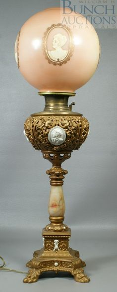 Gilt iron marble & brass banquet lamp, with cameo portraits, matching glass shade