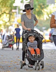 Miranda Kerr and Flynn out for a stroll in a City Mini on Fifth Avenue in New York City