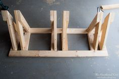 Build a homemade bike rack to help organize your garage! Wood Bike Rack, Diy Bike Rack, Bicycle Rack, Diy Rack, Bike Parking Rack, Truck Bike Rack, Bicycle Storage Shed, Bike Shed, Garage Velo